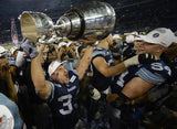 Jeff Johnson hoisting Grey Cup
