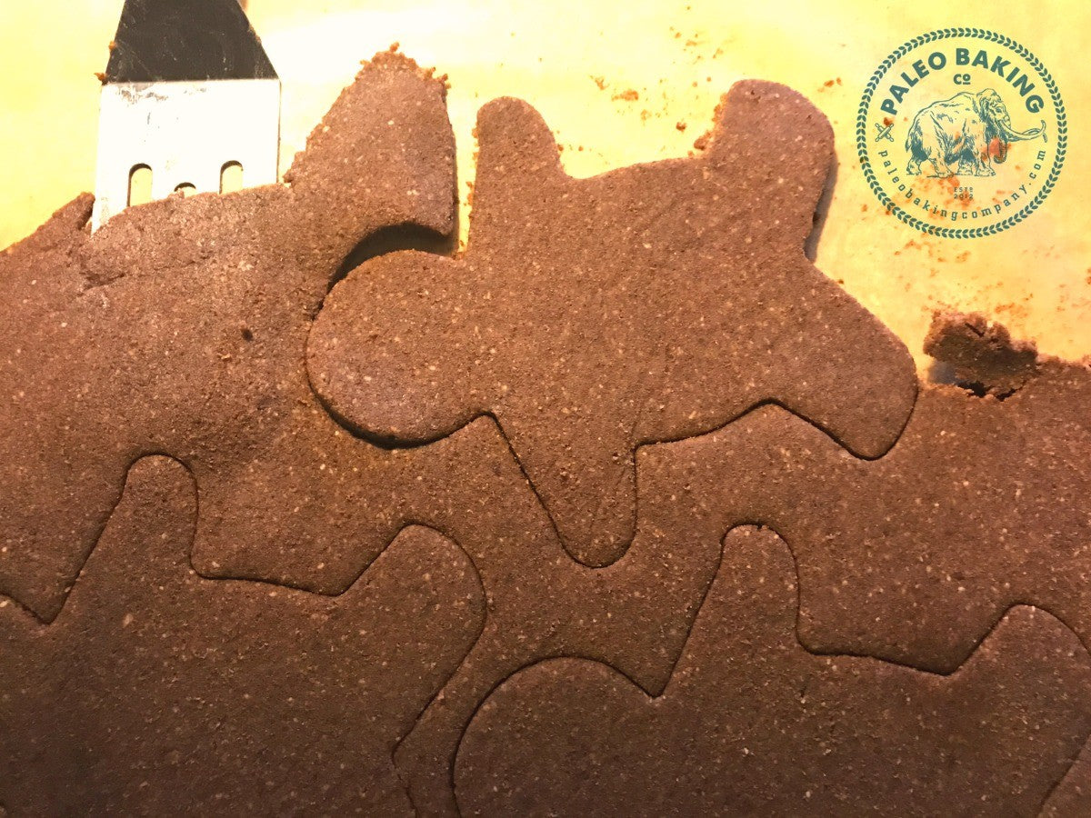 Paleo gingerbread cookie dough cut into shapes