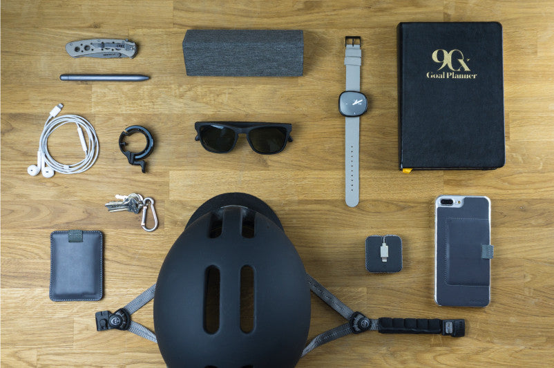 A cyclist's everyday carry includes MagLock Sunglasses and Wally Sleeve wallet