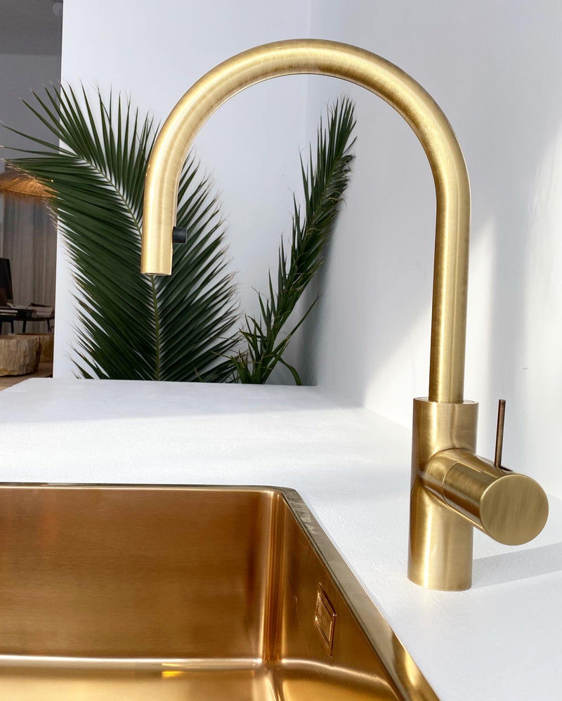 Kitchen mixer with pull-out shower in glossy bronze finish.