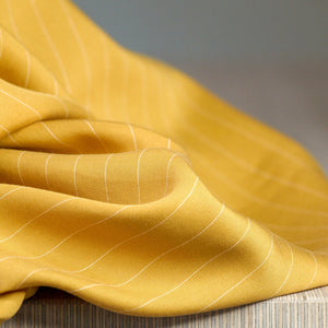 Eco-friendly Tencel Pin Striped Twill in Amber by Danish company meetMILK