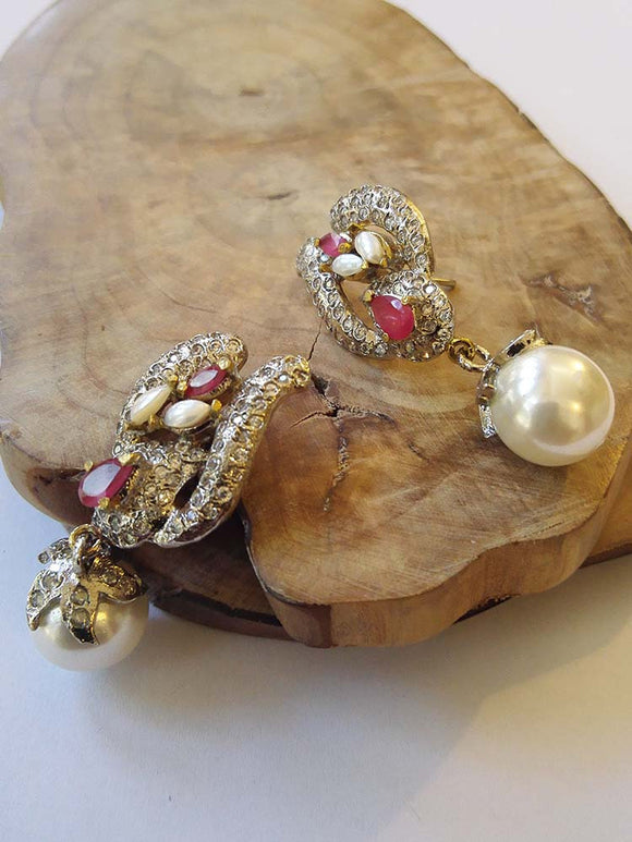 Designer and fine AD and Pearl earrings