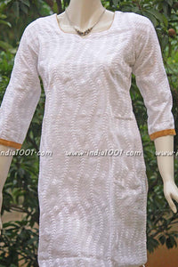 Elegant white cotton kurta with self embroidery