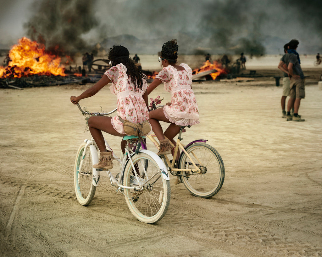 Girls cycling at Burning Man