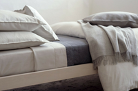 The Best Way to Make Your Bed for Fall & Winter