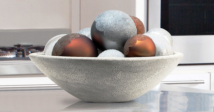 Place ornaments in an earthy bowl.