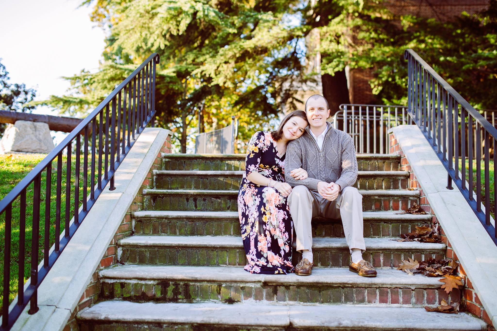 Portrait of a Couple Sitting on Brick Stairs Outside