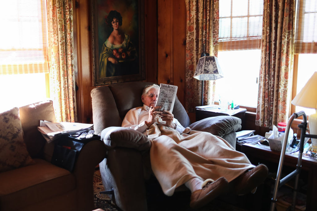 Elderly man reading while in a recliner | Quiet Time Photo Challenge