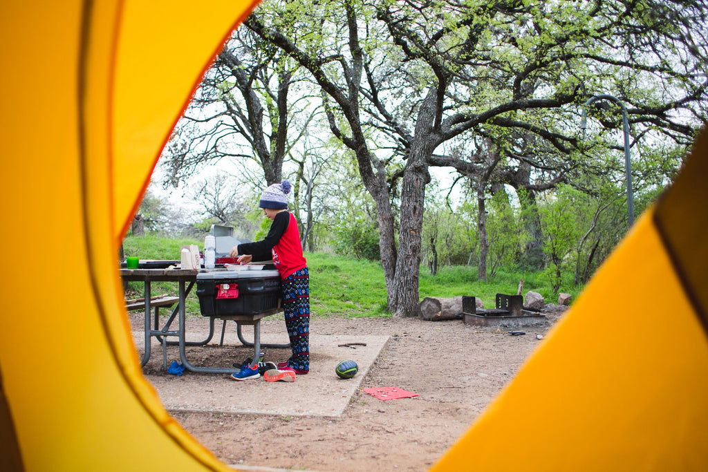 Boy making food while camping | Quiet Time Photo Challenge
