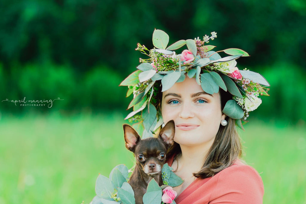 Phot of Woman holding chihuahua