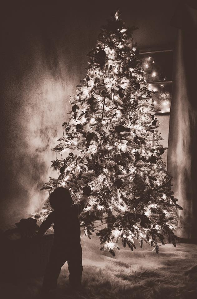 Black & White Photo of Child Pointing at Christmas Tree