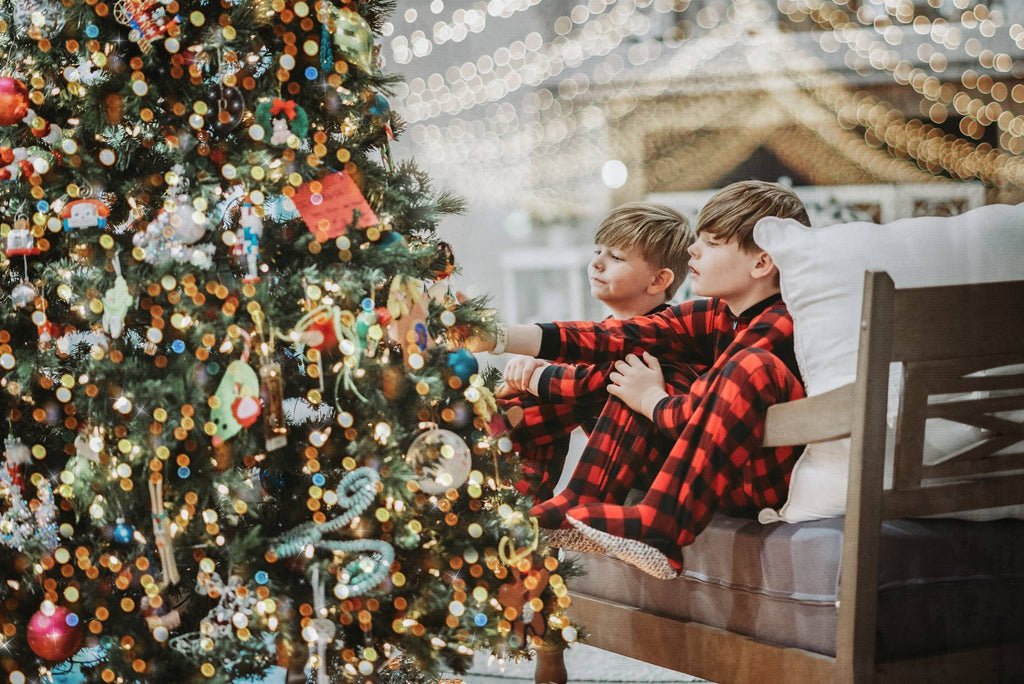 Photo of Boys Looking at Christmas Tree
