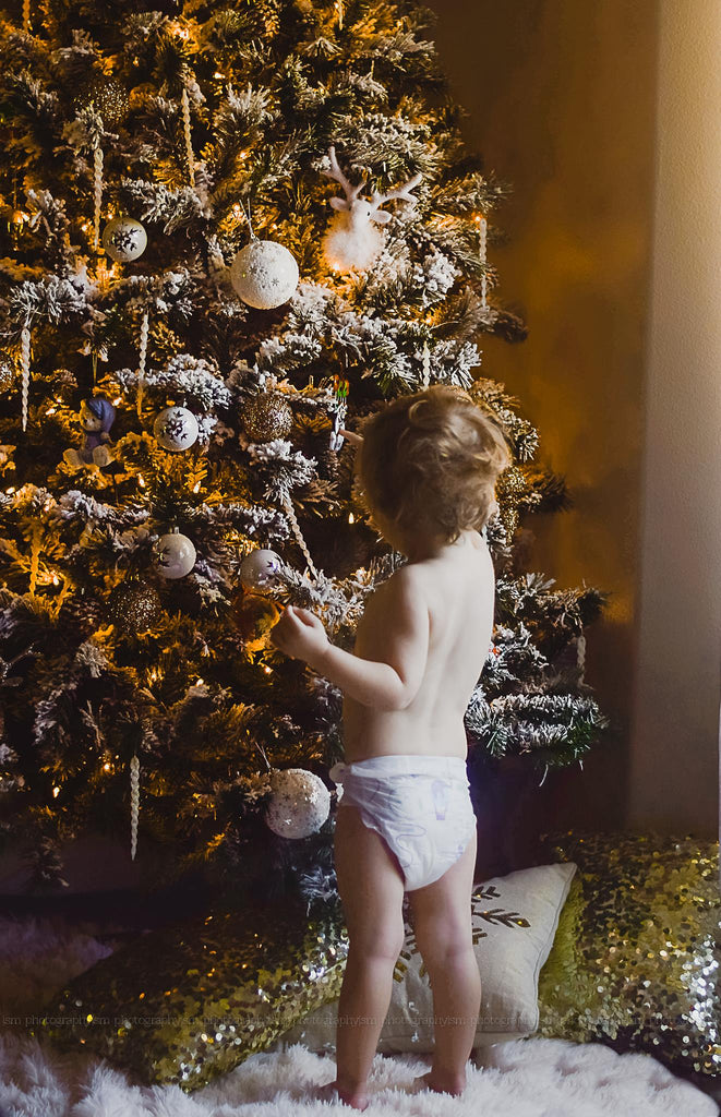 Picture of Child in Diaper Decorating Christmas Tree