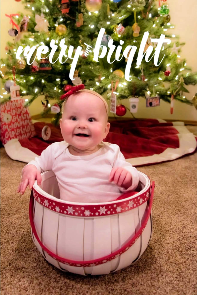 Baby In Basket in Front of Christmas Tree