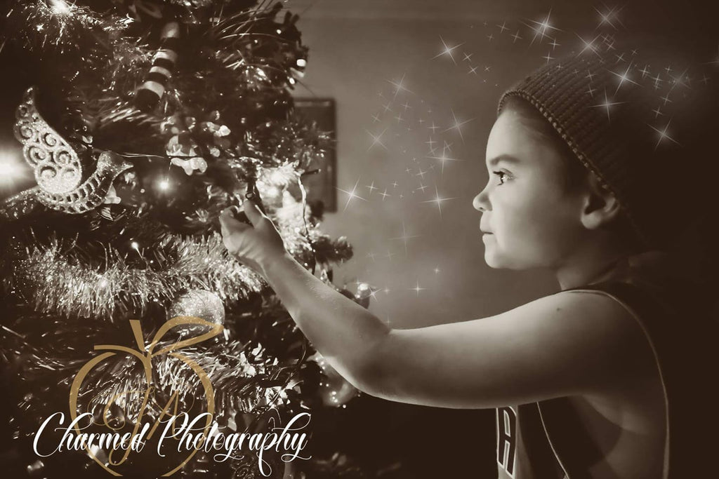 Photo of Girl Decorating Christmas Tree