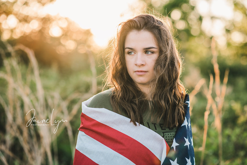 Photo of girl wrapped in American Flag