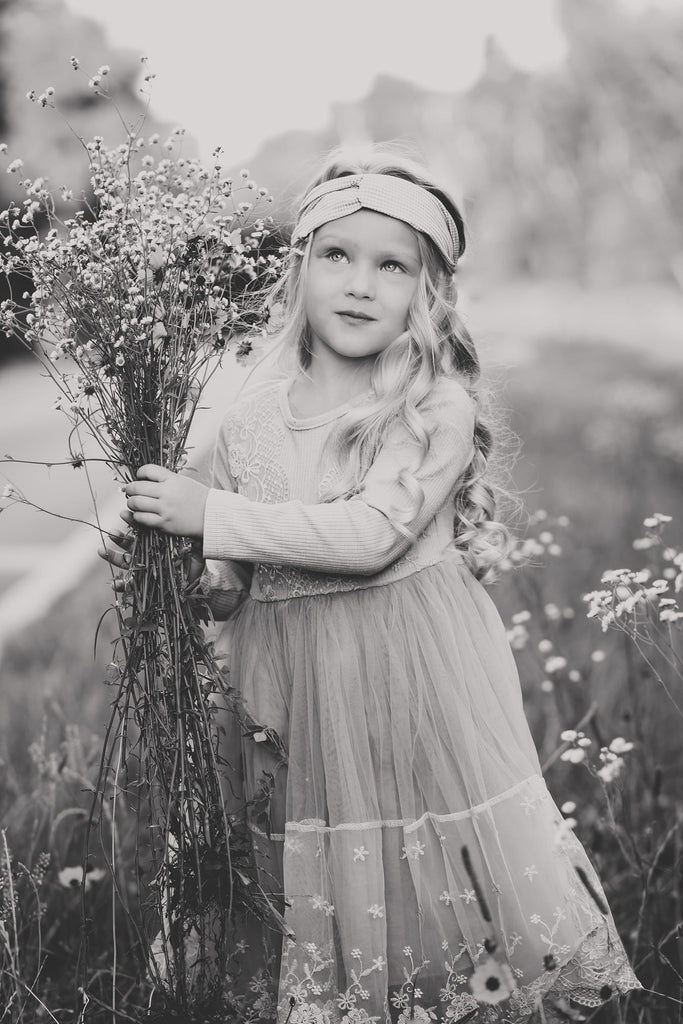 Photo of girl picking Spring wildflowers