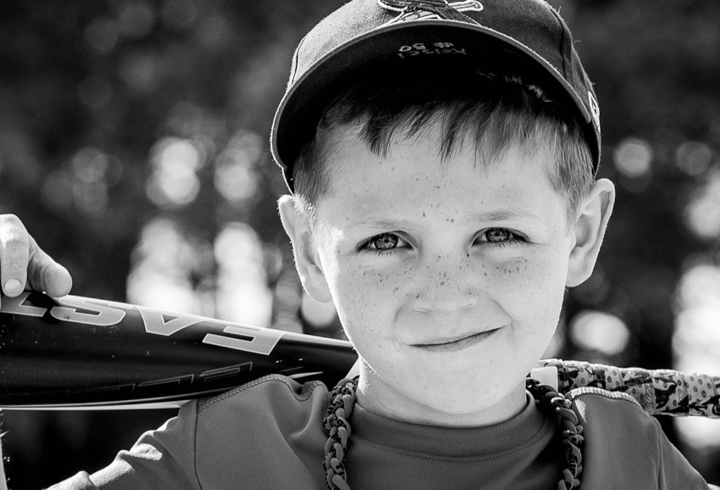 Black and white Photo of young baseball player