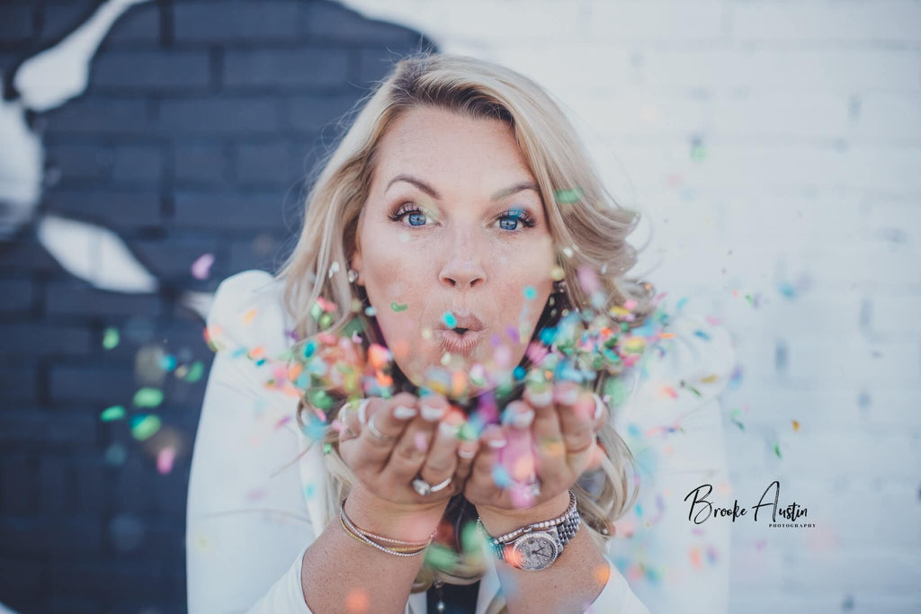 2019 favorite photos - Woman blowing confetti