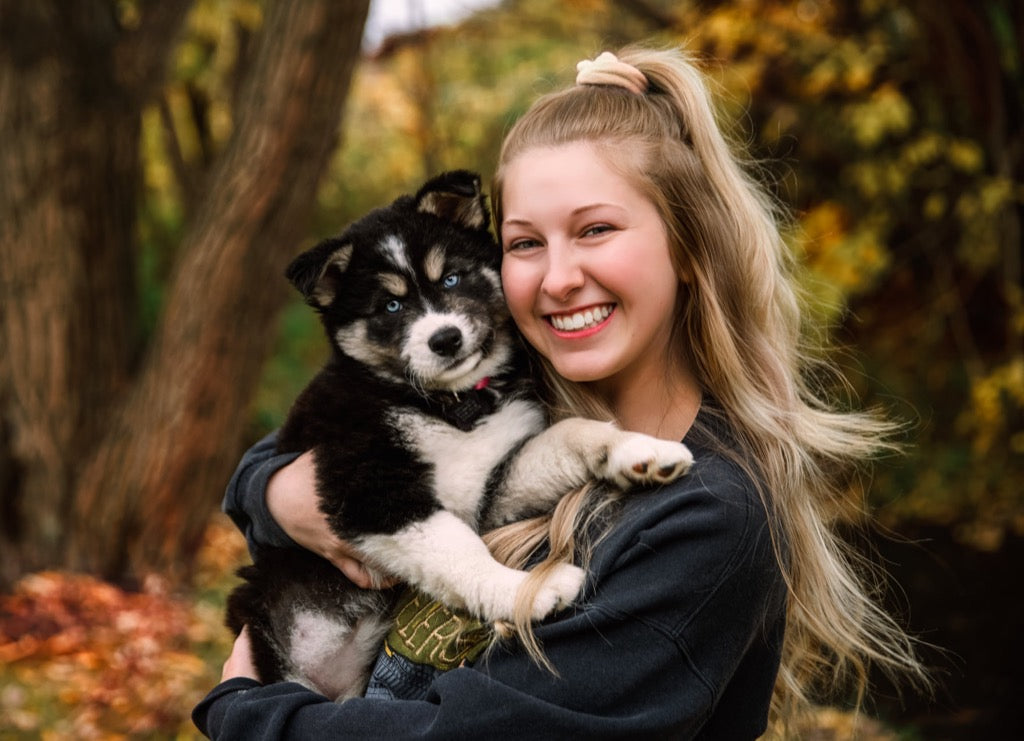 Dog and Owner smiling