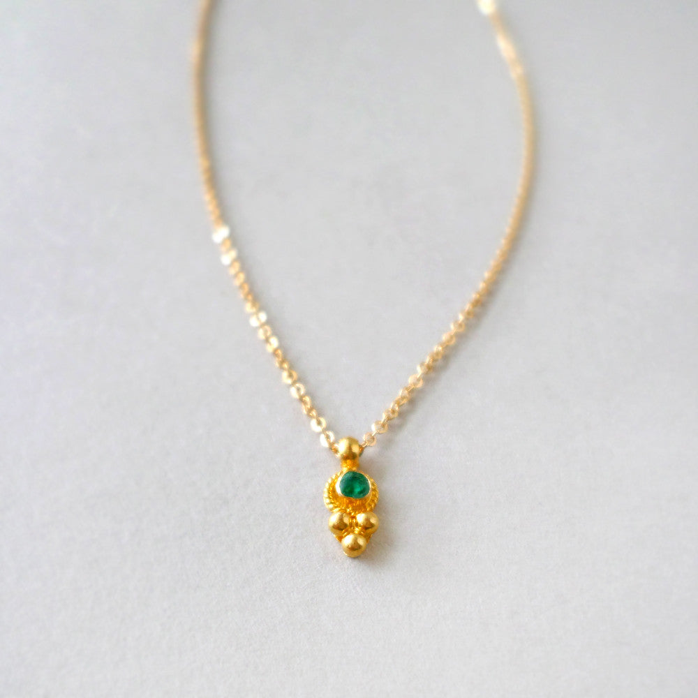 May birthstone emerald and gold necklace