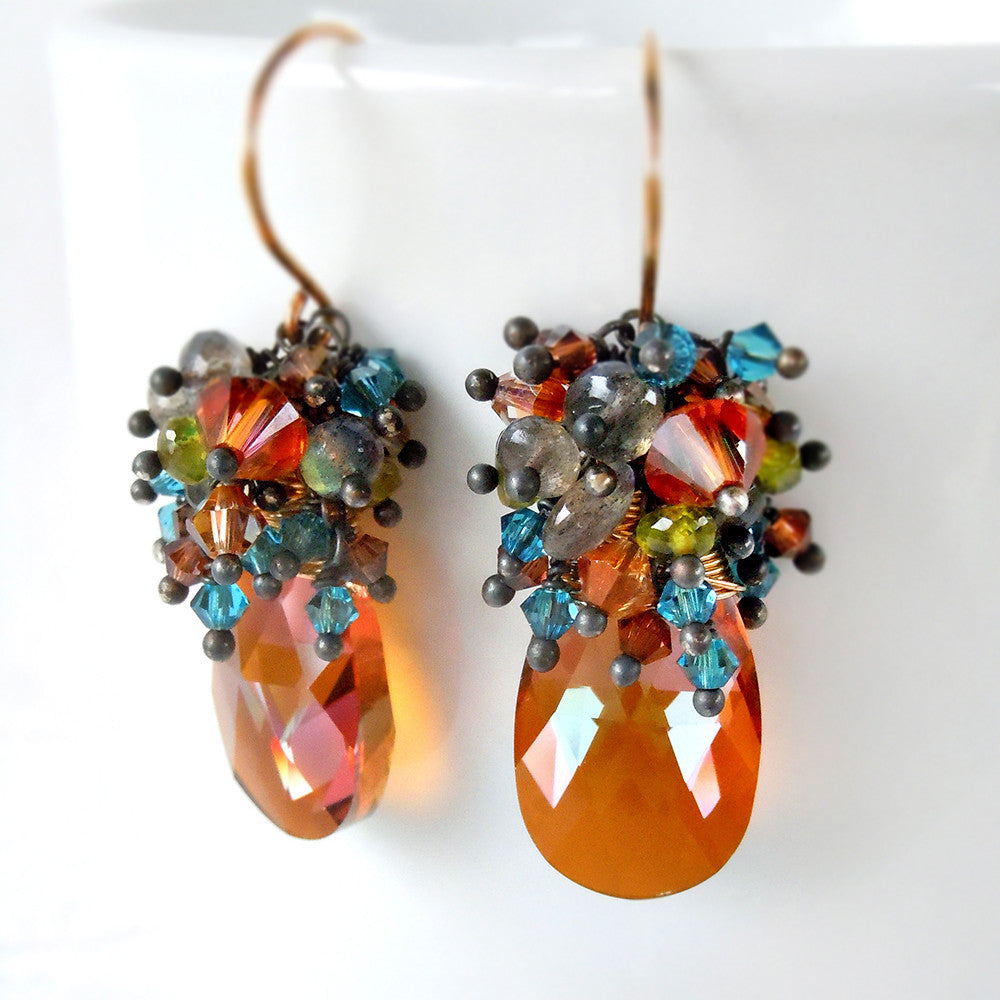 Crystal drop earrings with a colorful mix of orange, blue and green gemstones