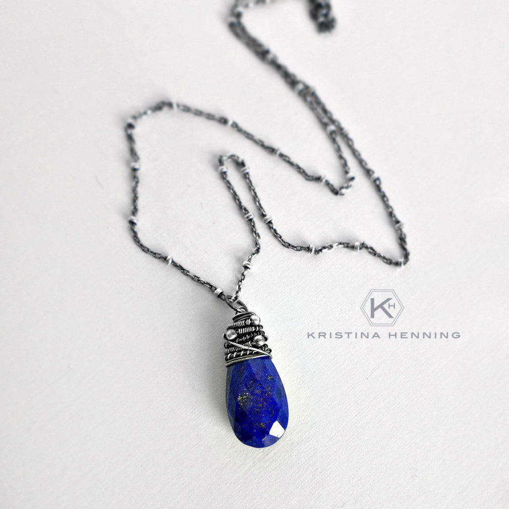 Royal blue lapis and oxidized sterling silver wire wrapped pendant necklace