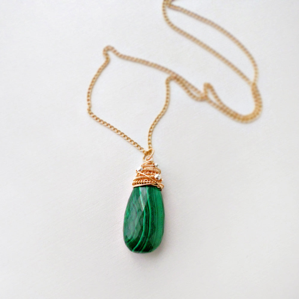 Green malachite wrapped stone necklace in gold