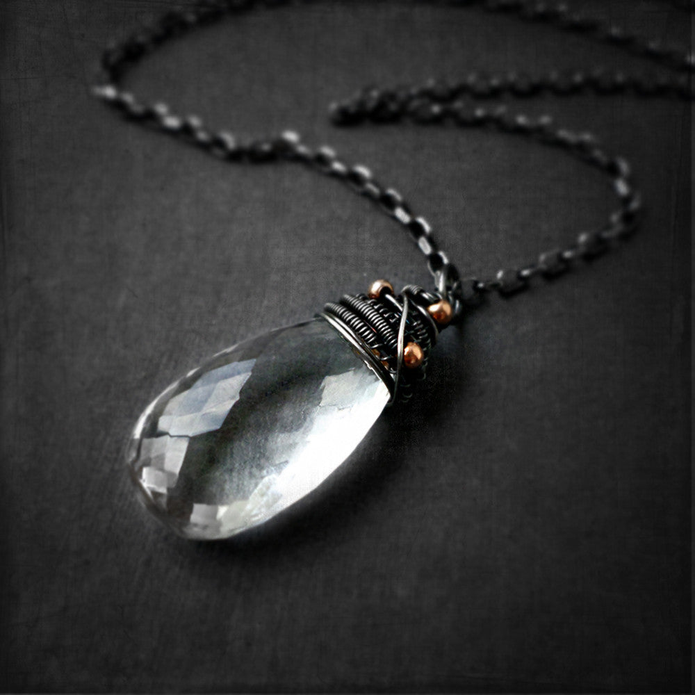 Clear quartz wrapped stone necklace in oxidized silver
