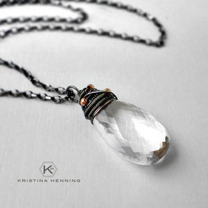 Wire wrapped clear quartz necklace in sterling silver
