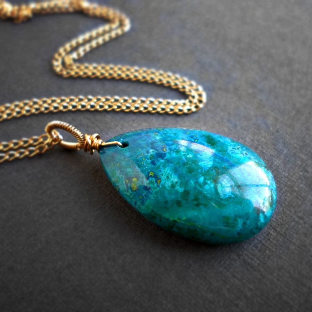 Chrysocolla pendant necklace on a long gold chain