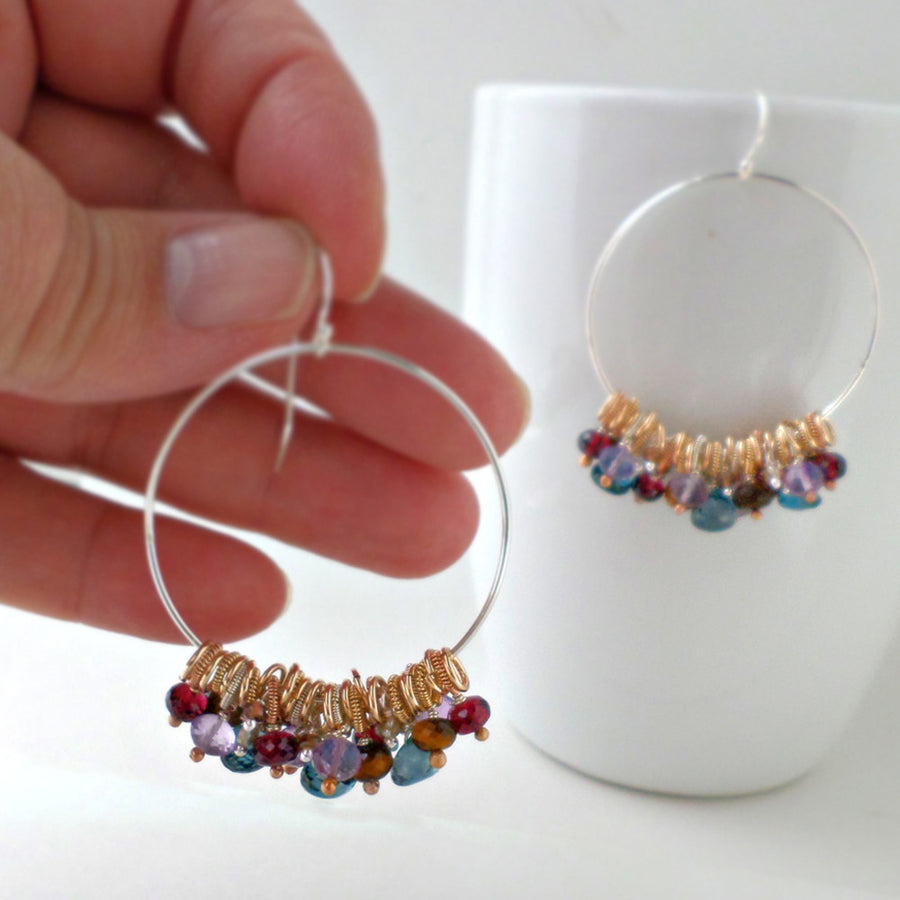 large silver hoop earrings with blue and red gemstones