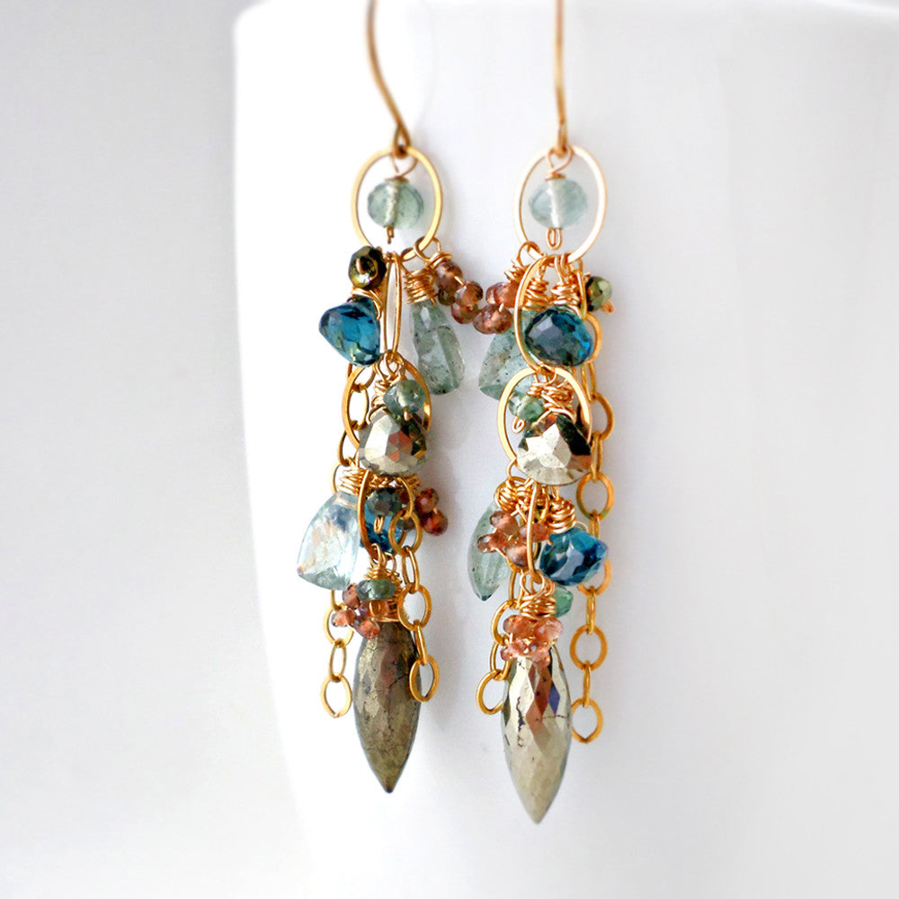Long dangle earrings with blue stones and gold