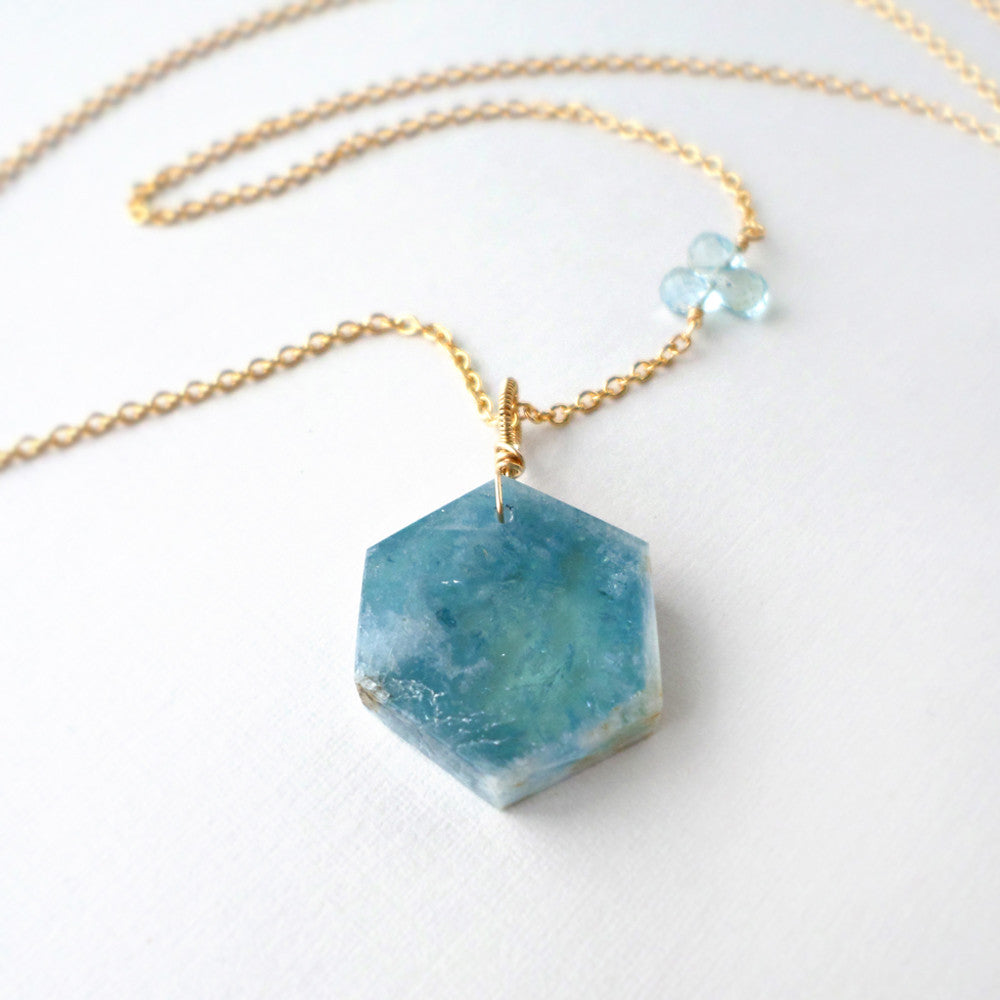 March birthstone necklace with light blue aquamarine slice and 14k gold