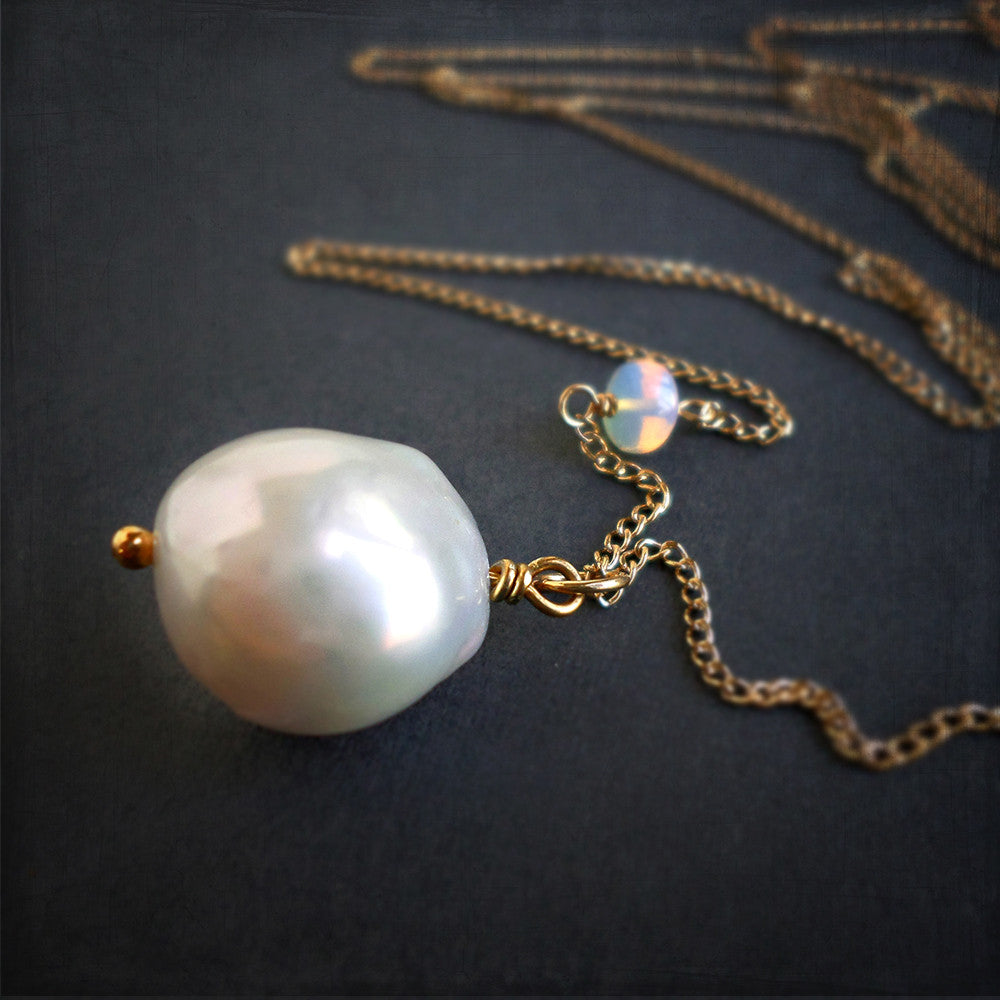 Large white pearl and gold long pendant necklace