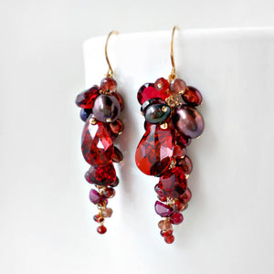 long red gemstone dangle earrings in gold with garnet
