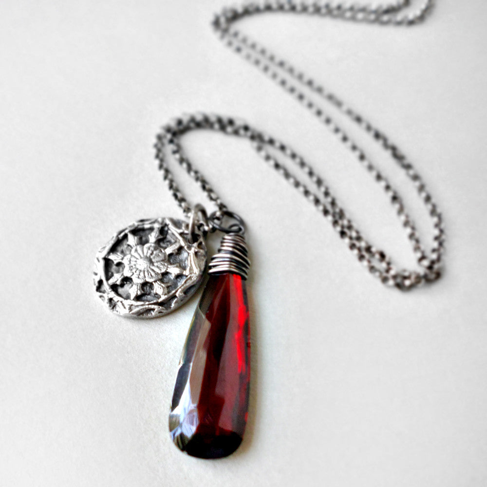 silver pendant and dark red quartz necklace