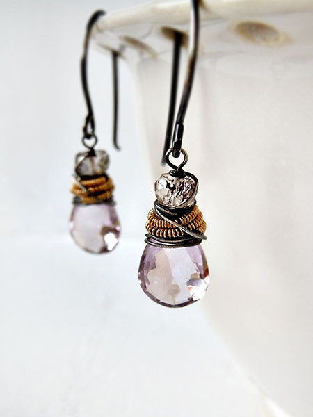 Light purple and pink amethyst drop earrings wrapped with silver wire and gold coil