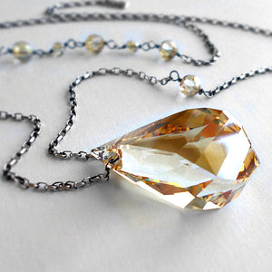gold crystal pendant necklace on a long sterling silver chain