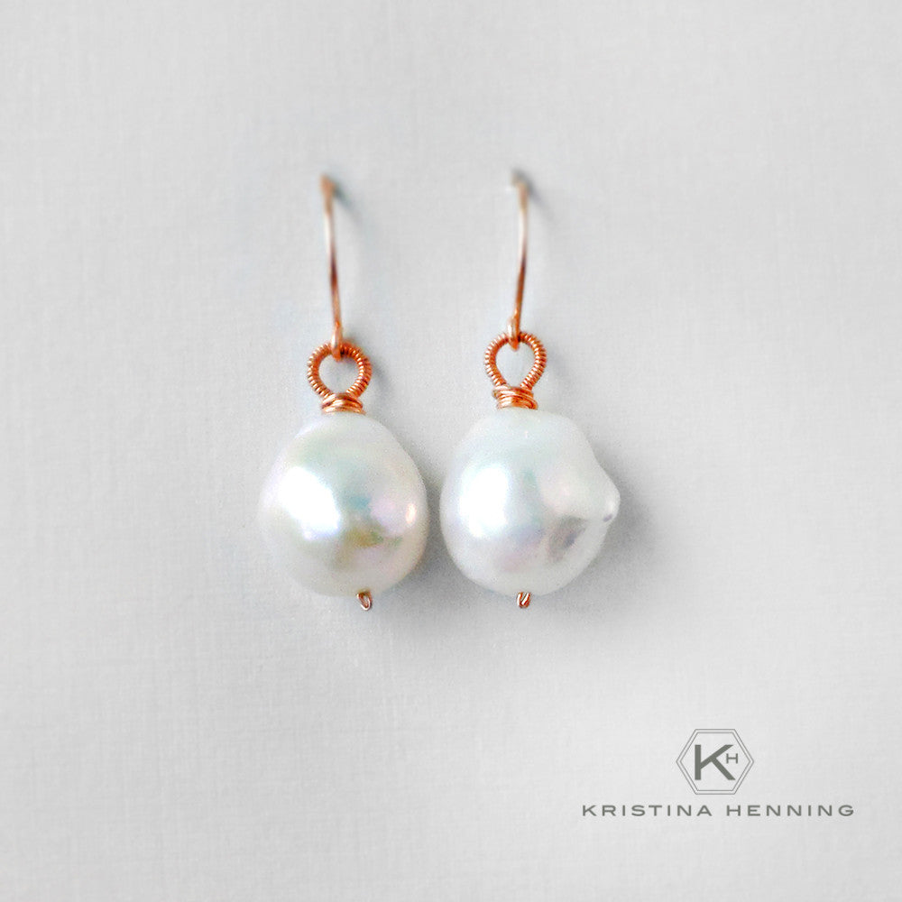 Large white pearl earrings inspired by Girl with the Pearl Earring painting
