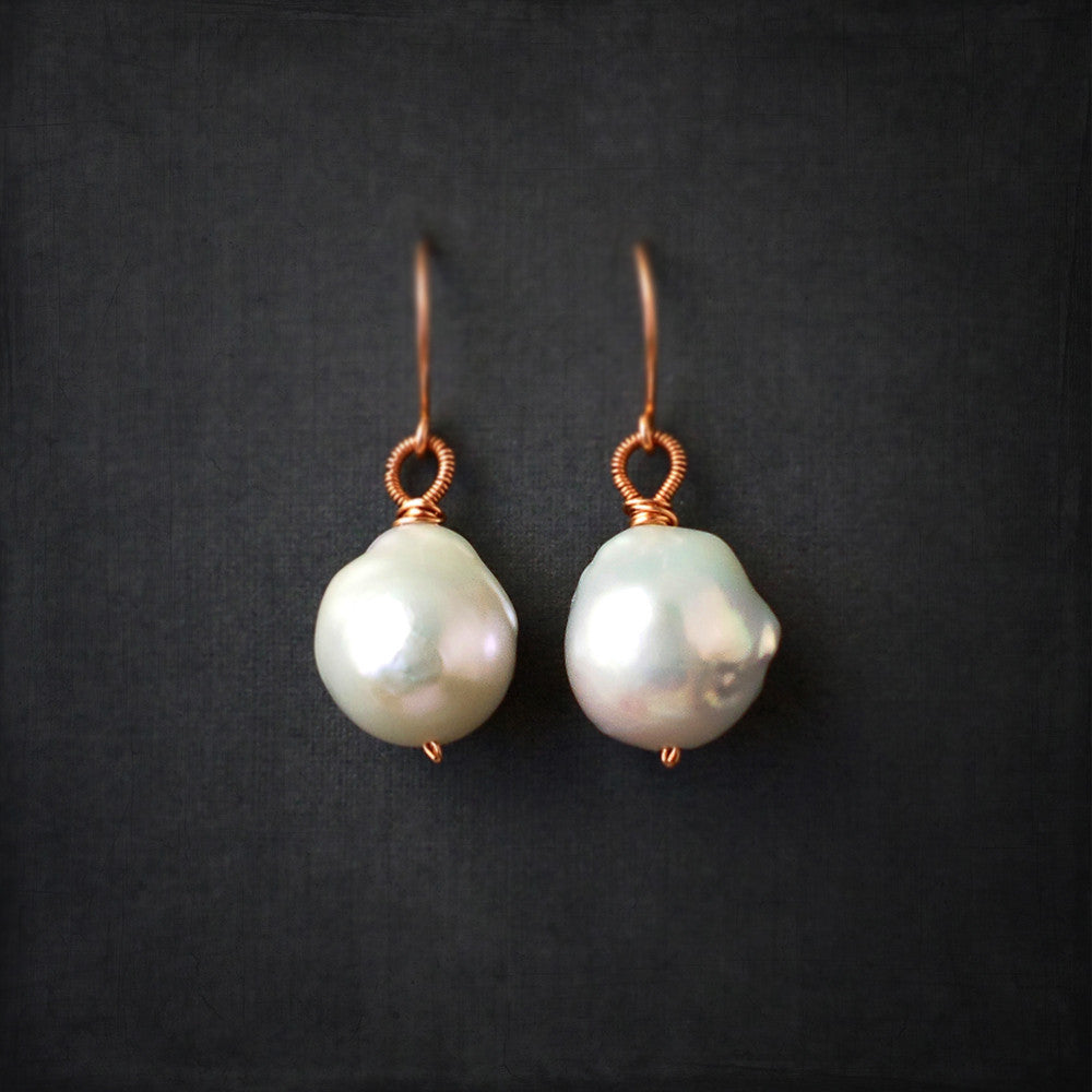 Large white pearl drop earrings in rose gold