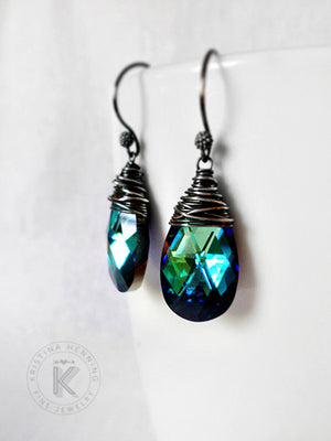 Silver wire wrapped crystal drop earrings with blue and green hues