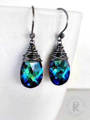 Dangle earrings made with blue and green crystal drops wrapped in fine silver wire