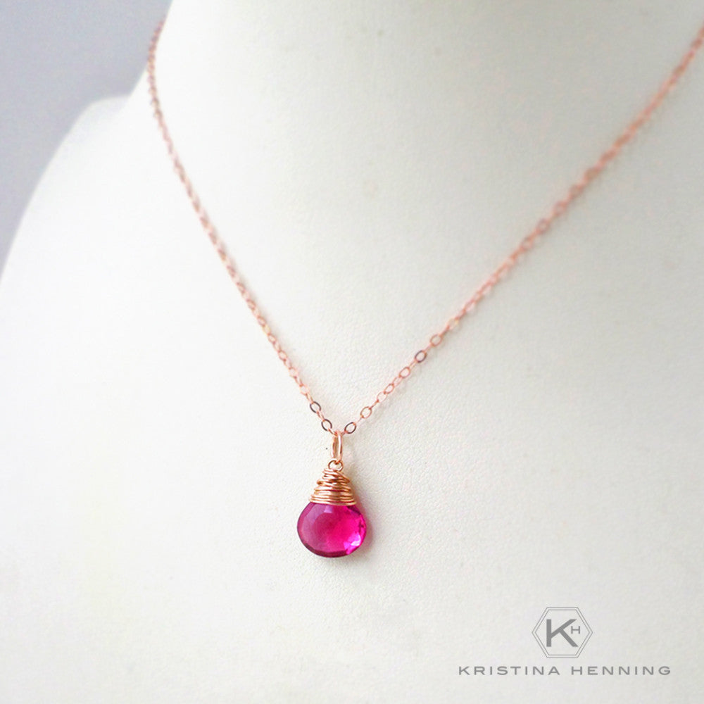 pink stone necklace in rose gold