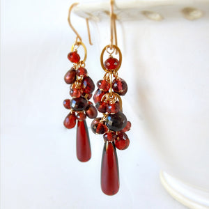 Red garnet and gold earrings with gemstone dangles