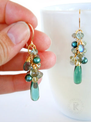 Gold dangle earrings with light teal quartz drops, blue-green moss aquamarine, blue flash labradorite and light green fluorite, and medium teal freshwater pearls