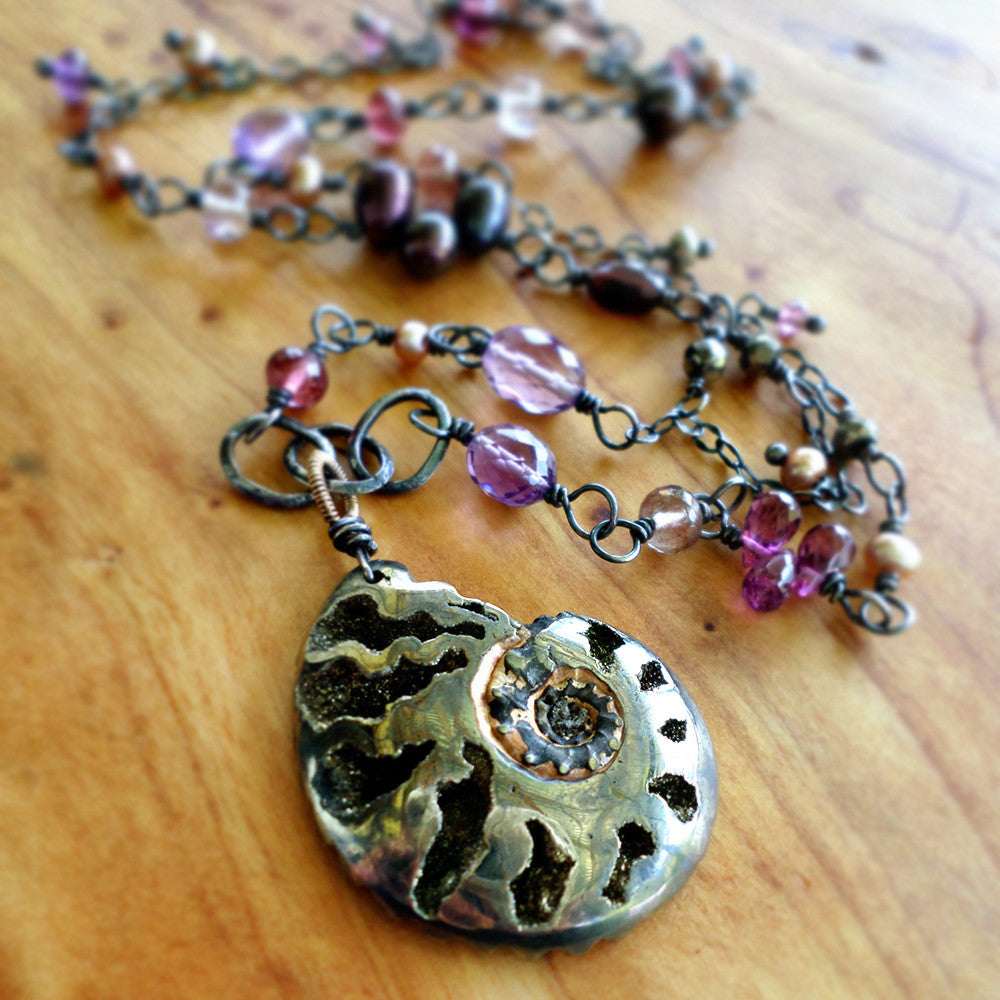 Ammonite fossil pendant necklace with amethyst, pearl, garnet and silver