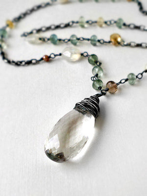 Moss aquamarine and sterling silver necklace with quartz pendant