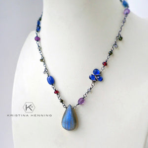 Blue gemstone necklace in sterling silver with labradorite, kyanite, amethyst and garnet