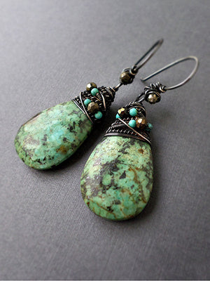 Gemstone dangle earrings in green turquoise and sterling silver